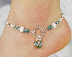 Triple dangle beaded anklet ankle bracelet made with an olive green and aqua blue semi precious fire agate donut bead, matching aqua blue