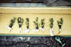 our handmade herb boutonnieres