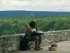 A musician playing the hang drum at Archery Field overlook - spring 2018