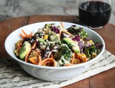 Hippie Bowls with Tahini Sauce - Quinoa, sweet potato, broccoli, chickpeas, purple cabbage, carrots, raisins, almonds, avocado with tahini, white wine vinegar, mustard, honey, cayenne, nutritional yeast