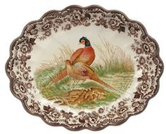 Spode Woodland Pheasant Oval Fluted Dish by Spode. $89.25. Woodland pattern dates back to 1828 and is produced on the Regimental Oak shape.. Dishwasher and microwave safe. Made of high-quality earthenware.. Makes a wonderful gift for family or friends.. 14- 1/2 inch. Spode's distinctive Woodland pattern depicts game animal and bird studies perfectly framed by a rich sepia-tone border of stylized Victorian flowers.  The Woodland Oval Fluted Dish measures 14- 1/2 inch and ...