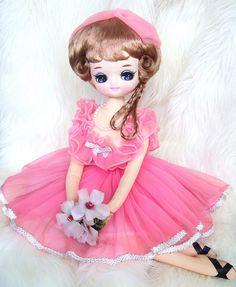 Pretty in Pink Bradley sitting doll