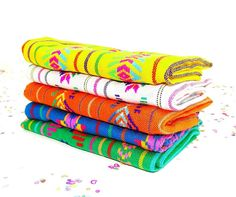 Half yard set of colorful, Mexican fabrics. These tribal fabrics are as bright in person as they are in the photos! These are machine embroidered lightweight knit fabrics and can be used for crafts, h