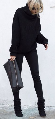 Black sweater and oversized clutch