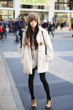 A fur hat with a fuzzy white coat and opaque black tights #NYFW #streetstyle #fashionweek