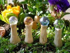 Fairies would love these gazing balls in my mini garden!!!