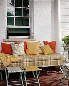 Turn a camp cot into an elegant patio daybed. Throw pillows in coordinating colors provide a soft surface to lean against. Depending on your sewing skills, you may wish to enlist an upholsterer for this project.