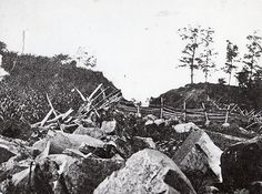 Picture of the Railroad cut that passed through McPherson's Ridge just west of Gettysburg. On July 1st, the Union right flank had begun to fall back under the weight of Davis' Confederate Brigade and the Confederates were firing from the railroad cut. The 6th WI, along with the 95th NY, and 14th Brooklyn changed front to the right and charged the cut, capturing many officers and men along with the flag of the 2nd MI.
