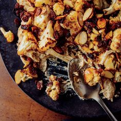 Cauliflower Korma with Blackened Raisins  | Warm spices infuse the creamy curry in this Cauliflower Korma with Blackened Raisins. Toasting the raisins magnifies their tart and sweet sides while adding a touch of smoke. Get the recipe Food & Wine.