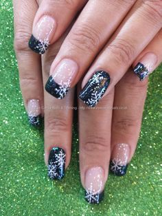 Black glitter polish with christmas snowflake nail art