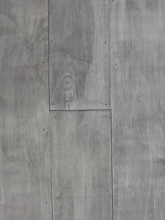 DIY gray plywood plank flooring - I would cover with a wax or matte sealant