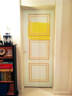 and THIS is how we will fix the horrid, boring doors in our house. we were all set to replace them, but alas...we can just add molding for a fraction of the cost :)