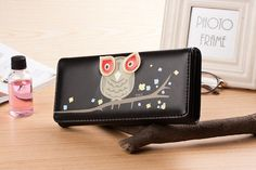 Stylish black leather purse with cute owl design. Beautiful ladies fashion accessory for all age groups. This pretty faux leather owl purse will fit all your money, coins and cards in one place and keep it secure at all times. The spacious interiors include three note compartments, one large zipped coin pocket and handy slots for at least five bank/store cards. A women's dream! Gorgeous owl design and timeless black colour make this unique purse a fashionable and chic way to carry your money…