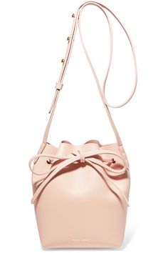 Mansur Gavriel re-imagines its signature bucket bag in a soft pastel-pink shade for Spring '17. Crafted in the Veneto region of Italy from smooth leather, this mini design is free from pockets and lining to maximize its sleek, minimalist feel. Carry yours cross-body by the adjustable shoulder strap.