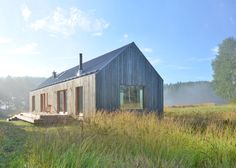 MNy Arkitekter has used seven varieties of timber to create this gabled house on the shoreline of a small lake in Tenala, Finland