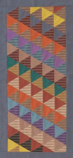In each diagonal row of this table runner, triangles alternate between soft stripes and heathered solids. Points of the equilateral triangles will match up perfectly, making stitching a breeze.