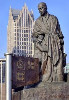 History 101 with Davinci the Detroit dog; Detroit Underground Railroad Monument on Riverfront