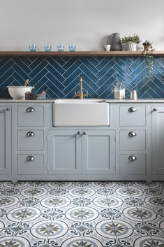Your kitchen floor has to put up with a lot; spilt food, muddy feet and high tra… Your kitchen floor has to put up with a lot; spilt food, muddy feet and high traffic. Whether you want a bit of character or a sleek finish… Wooden Kitchen Floor, Kitchen Wall Tiles Design, Modern Kitchen Tiles, Kitchen Flooring, Interior Design Kitchen, Blue Tile Backsplash Kitchen, Patterned Kitchen Tiles, Blue Tiles, Blue Walls Kitchen