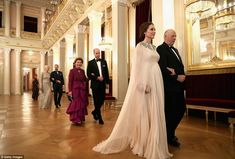 William wasn't far behind his pregnant wife, as he accompaniedQueen Sonja of Norway who was wearing a ruffled deep pink dress behind her husband