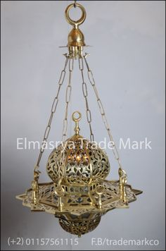 Arabic Gold Brass Hanging Lamp Lantern/Chandelier Lighting - # CH-100 The weight is 10 KG approximately. The height is 50cm – without chain - . The overall height with chain is 90cm and 50cm width from the widest point. Hand made in Egypt, the lamp body is 100% made of brass with Moroccan Design , It adds a uniquely foreign touch to your home! . Avaliable in Gold, Oxidize  Also available in metal plated with brass upon request .
