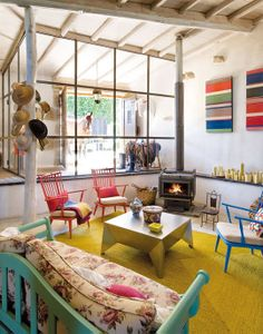 Rustic Warmth and Color in Spain — Elle Decor-cool way for horses to visit