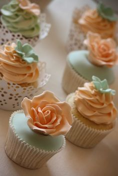 Pretty mint and peach wedding cupcakes