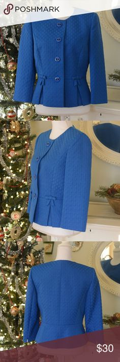 Tahari Arthur S. Levine Blue Jacket This sophisticated, blue jacket from Tahari Arthur S. Levine is an absolute stunner. Quality cut, embossed material, light padding in shoulder area. 58% cotton; 42% polyester. Size: 6. Tahari Jackets & Coats
