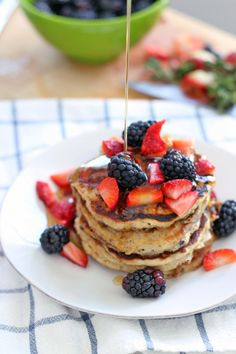 Fluffy Berry Oat Pancakes   are just that- they are made with 100% whole grains (a mixture of whole wheat flour and oats) and only 2 tablespoons of brown sugar (for which honey can be substituted- see recipe below). The flavor is slightly sweet and salty, kind of like a biscuit, balanced out by the natural sugars in the fresh (or frozen) berries that are folded into the batter. @evetlin