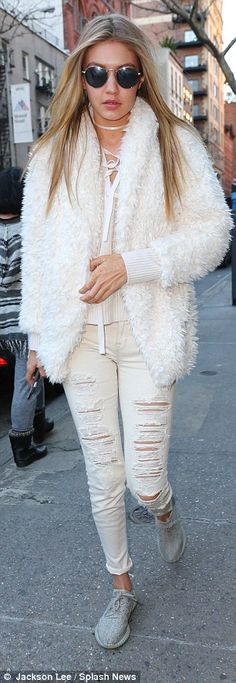 She's ripped! Completing the look were a pair of tattered white jeans and grey trainers...