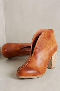The slitted front helps elongate the legs! Antelope High Color Booties | Anthropologie