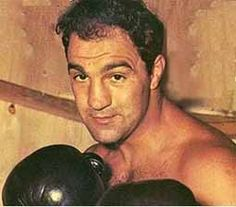 "Rocky Marciano faced the world heavyweight champion Jersey Joe Walcott on September 23, 1952. Though Walcott dropped Marciano in the first round in the thirteenth Marciano's ""Suzie Q"" right cross knocked Walcott out and Marciano became the heavyweight champion of the world. Rocky Marciano Bio     Joey Maxim defeats Sugar Ray Robinson by knockout to retain his world light heavyweight title.     1st sporting event televised nationally was a boxing match between Joe Walcott and Ezzard Charles."