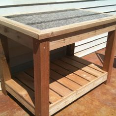 DIY potting table made by my dad and Eric with scrap piece of granite Diy House Projects, Furniture Projects, Furniture Plans, Diy Furniture, Granite Table Top, Granite Slab, Granite Countertops, Marble Slabs, Grill Table