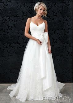 modern sweetheart spaghetti straps lace and tulle wedding dress with removable bow. $275.00, via Etsy.