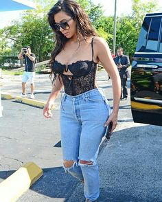 Kim Kardashian street style with denim jeans.
