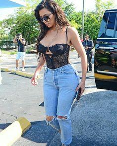 Kim Kardashian street style with denim jeans.