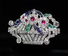 "Art Deco brooch, ""flower vase"", platinum, diamond, ruby, sapphire, emerald."