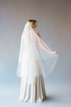 ELLENA VEIL DESCRIPTION: waltz length circle veil Veil is made of soft bridal illusion tulle and has a raw cut rounded bottom edge. Veil is