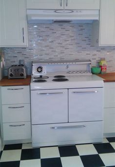 Before & After: A Vintage Stove Spurs an Entire Kitchen Remodel — Reader Kitchen Remodel ---- Especially floor