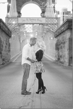 Riverside Drive in Covington, Kentucky is a great location for engagement photos. You have a great mix of rich architecture, city streets, the Roebling Bridge, overgrown ivy and the Cincinnati skyline. Photos by Pottinger Photography: www.pottingerphoto.com