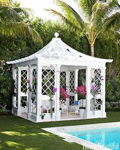 Quaint pergola idea and pool landscaping design.