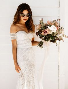 heart sunglasses and off-the-shoulder wedding dress