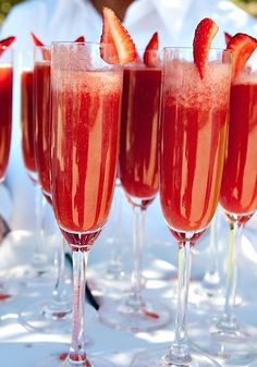 wedding signature cocktail. champagne with strawberry puree