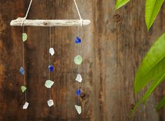 Make a seaglass mobile, using dollar store seaglass