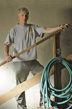 hmmmm, makes One wonder if he is thinking -- How the Hell will I get That Boat out of this Basement ...  lol <3 this pic