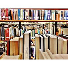 """""""Stacks."""" A view across the books in Cowles Library @ Drake University. Jack Hellie, a first-year politics major. #DrakePOTD"""