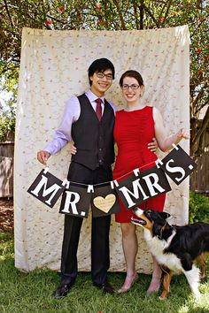 """""""Mr. & Mrs.""""  I just like the idea of a sheet as the background of a picture. Photo booth -- ghetto & yet classy. Lol."""