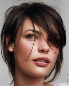 Gorgeous complexion, high arched brow, lusciously long eyelashes, attractive green eyes, high cheek bones, cute nose, sexy lips, fantastic hairstyle, make-up that enhances all the assets - young, fresh and beautiful