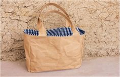 Danielle Manor's bags are made out of a water resistant material which looks like paper.