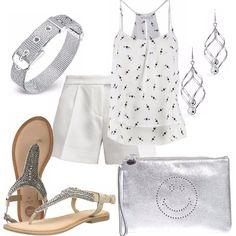 La semplicità e la sobrietà del bianco di sposa in questo outfit con il silver. Pantaloncino bianco di taglio classico, abbinato ad un top bianco con piccoli disegni neri. Sandalo infradito in cuoio interamente ricoperto di pietre argentate. Accessori argento.