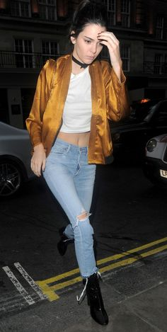 Wearing a burnt-orange satin bomber over a crop top and Citizen of Humanity jeans in London.